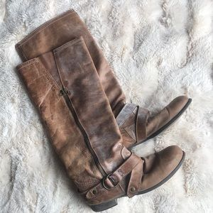 Steve Madden Tan distressed look knee high boots.